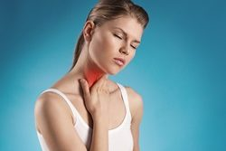 Angina virus. Young woman having throat pain.